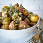 Best potato salad recipe that is both Whole30 & mayo-free. Full of herbs and garlic.